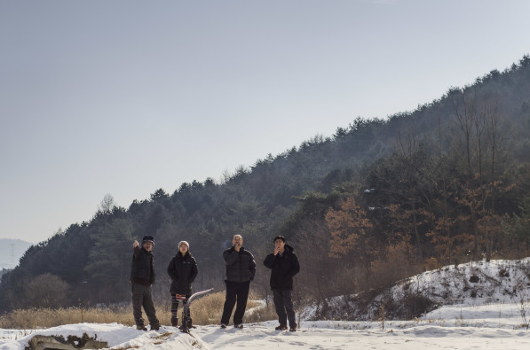Korean natural farmers survey conditions on a winter field in Hongcheon, South Korea (Photo: P.M. Lydon / Final Straw)