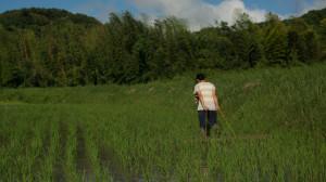 Trying out human-powered farm tools at a natural rice farm in Awaji, Japan