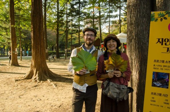 Patrick Lydon and Suhee Kang pose for a photo during their nature art workshop at Yangjae Citizen's Forest in South Korea (photo by SocieCity)